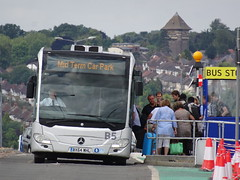 Leaning bus (stevenbrandist) Tags: lutonairport travelogue carpark bus mercedesbenz mercedes cones trafficcones cone midtermcarpark bx64whl