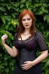 Corset (piotr_szymanek) Tags: minerwa woman young skinny portrait ouitdoor face redhead transparent lingerie hand green leaves black dress corset 1k 20f 50f outdoor 5k 10k 100f 20k