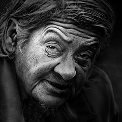 Black and white face (Ales Dusa) Tags: woman portrait bw greyscale outdoor candid homeless face alesdusa canon streetportrait strongcontrast human humanity people closeupportrait canoneos5dmarkii ef70300mmf456lisusm elderly wrinkles blackandwhite look eyes facial portraiture striking natural light hardlife