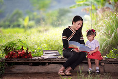 Vietnamese So Beautiful (Wonderful Vietnam) Tags: child reading mother parent book family daughter happy teaching kid adult girl children woman little together teacher education cute beautiful two people learning cheerful childhood smiling park young female parents day love bright joy leisure kids nature green study asian read person story white caucasian mom fun lifestyle home small