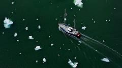 "Weaving Among Iceberg ""Bits"" in LeConte Bay (Ginger H Robinson) Tags: aerialview aerial iceberg ice bits lecontebay bay green tidal water sailboat boat"