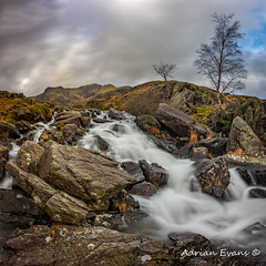 River Mountain Snowdonia (Adrian Evans Photography) Tags: capelcurig snowdonia squareformat winter idwal water panorama idwalstream ogwenvalley wales tree northwales devilskitchen glyderaumountains welshlandscape cwmidwal landscape snowdonianationalpark nationalpark stream outdoor llynidwal clouds longexposure river adrianevans smooth ogwen mountains landmark rocks waterfall sky