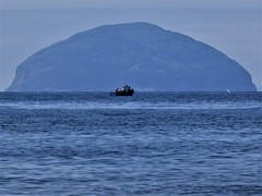 Obstacle (Tobymeg) Tags: fishing boat ailsa craig scotland sky rock sea panasonic dmc fz 72 curling stone granite asof2004 60–70ofallcurlingstonesinuseweremadefromgranitefromtheisland