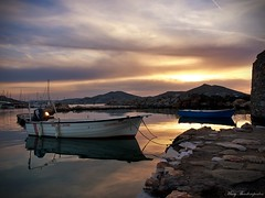 Cloudy sunset at old port (mary.th) Tags: boats clouds sky sea sunset reflections rocks sunlight old port naoussa paros greece island cyclades