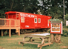 110 Film Caboose and Library (Neal3K) Tags: georgia 110film lomotiger200film williamsonga caboose red southernrailway littlefreelibrary picnictable southernx744 baywindowcaboose