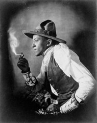 """""""Sioux Indian Smoking a Cigarette"""" (c. 1908).  Library of Congress Prints and Photographs Division. Unknown photographer (copyrighted by John A. Johnson, W. Somerville, Mass.) (lhboudreau) Tags: whitescarf scarf americanindian nativeamerican portrait hat vest leather cowboy 1908 wristband antiquephoto vintagephotography vintagephoto indianman cigarette smoker siouxcigarettesmoker smoking bracelet beadedbracelet beadedwristband sioux siouxindian dakota dakotaterritory greatplains dakotaindian johnajohnson thecigarette blackandwhite bw monochrome blackwhite belt leatherbelt leatherhatbelt"""