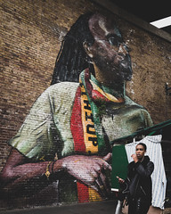 a short story about two faces (ignacy50.pl) Tags: street streetphotography streetart people woman girl face mural graffiti colors painted bricks wall london