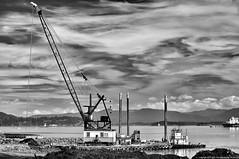 2013-08-16 Custom Plywood Mill Site (B&W) (2048x1360) (-jon) Tags: anacortes skagitcounty skagit washingtonstate washington salishsea fidalgoisland sanjuanislands pugetsound fidalgobay rebar concrete rubble customplywood plywood mill publishersforestproducts crane derrickbarge barge sky clouds dredging ecology cleanup polution ruins abandoned bw blackandwhite a266122photographyproduction orion tugskagit boat ship vessel