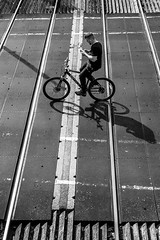 No Hands (EightBitTony) Tags: shadow traintracks towncentre derbyshire streetphotography longeaton bike town man urban canon7d2 lines contrast august person cycling blackandwhite 2019 uk cycle bw blackwhite canon canon7dmarkii canon7dmark2 canon7dmk2 canon7dii canondslr canoneos canoneos7dmarkii canoneos7d2 canoneos7dii mono monochrome nottingham england unitedkingdom