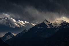 Evening thunderstorm over the Swiss Alps (David M. Stucki) Tags: alps alpen mountain snow schnee berg berge switzerland schweiz wallis valais weisshorn blue landscape landschaft storm sturm rain regen gewitter tunderstorm canon canoneos5dmarkiv ef100mmf28lmacroisusm atmosphere nature natur new neu abend evening david manuel stucki magic cloud wolken sky himmel stimmung licht light outside törbel