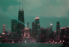 Chicago Skyline in LomoChrome Purple (Jovan Jimenez) Tags: lomochrome purple film 200 iso chicago skyline tiltshift bokeh canon eos rebel t2 hasselblad f carl zeiss planar 80mm f28 35mm 300x kiss7 night lights