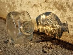 Dusk Proof (Robert Cowlishaw (Mertonian)) Tags: bottle glass shadow evening dusk mertonian robertcowlishaw recycle canon powershot g1x mark iii canonpowershotg1xmarkiii sideways cement concrete empty texture