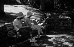 Listening (bingley0522) Tags: leicaiiic zeissjenasonnar50mmf15ltm trix hc110h epsonv500scanner lithiapark ashlandoregon parkbench family listening hats saturdaymorning peaceful autaut