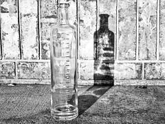 Clarity in BW (Robert Cowlishaw (Mertonian)) Tags: bw blackandwhite mertonian robertcowlishaw dusk shadow texture glass bottle cement concrete canon powershot g1x mark iii canonpowershotg1xmarkiii sunset stilllife brick
