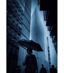 Mark Fearnley © (eyephotomagazine) Tags: photo photography street streetphoto streetphotography london future futurelondon mark fearnley feature featured artist art artistic streetphotograph light shades shadows lightandshades lightandshadows lightandcolors color colors blue rain rainyday umbrella futuristic instagram instadaily instagood daily zine magazine photomagazine eyephotomagazine