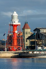 Port Adelaide, South Australia (sgiles46) Tags: 1869 adelaide attraction beacon blue commercialroad cyclist editorial flags guide hexagonal historic historical history icon iron landmark lantern light lighthouse maritime markets mclarenwharf museum navigate navigation old port portadelaide portriver portraitorientation red safety sky southaustralia structure sunny sunshine tourism tower transport vintage white