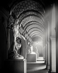 Surrounded by darkness yet enfolded in light (Juan Figueirido) Tags: bw blancoynegro blackandwhite statue light shadow gallery france lyon