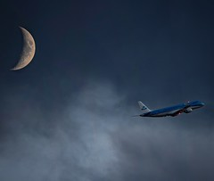 Waxing Crescent and an Evening Departure (Aleem Yousaf) Tags: moon waxing crescent luna evening sky clouds moody overcast london city airport takeoff klm nikkor d850 craters space impact light celestial 300mm prime tc camera digital plane spotting royal dutch embraer erj190 back garden