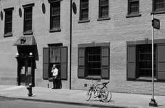 Cigarette Break (Kenneth Laurence Neal) Tags: newyorkcity cities urban street streetphotography bicycles people building sidewalk blackandwhite blackdiamond monotone monochrome nikon nikond7100 digital noir
