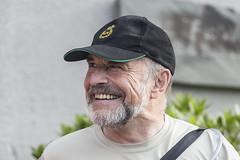 Happy Man (Frank Fullard) Tags: frankfullard fullard candid street portrait happy smile face expression beard cap gentleman color colour irish ireland castlebar walker walkingfestival