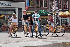 yellow bikers on the square (pazitri) Tags: street candid amsterdam city people pazitri paz bike biker bicycle pavement sidewalk
