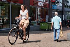 sidewalk biker (pazitri) Tags: street candid amsterdam city people pazitri paz bike biker bicycle pavement sidewalk
