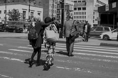 Sisters crossing the street, showing love... (Capitancapitan) Tags: crossing street photography sisters people walk neury luciano pop rock urim y tumim el mundo gira cuestion de piel merengue bachata black white photo pentax camera k50 k70 k500 image beautiful nyc new york iphone apple tv radio youtube instagram facebook bronx manhattan yonkers upstate