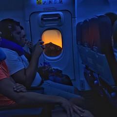 A window on the sunset. A plane window. (barronr) Tags: picoteide mountain tui nightflight sleeping people plane window sun spain canaryislands tenerife sunset