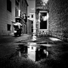 (Samuli Koukku) Tags: croatia brac bol travel streetphotography street monochrome bw blackwhite ilford fp4 filmphotography film hasselblad 500cm 50mm mediumformat 6x6 motorsport reflection summer 2019 city cityscape zeiss distagon