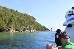 Flock of Tourists to view rock pillars (daveynin) Tags: rockpillars seastack geology island blueheroncruises fathomfive nationalmarinepark brucepeninsula flowerpot bay georgianbay tourist