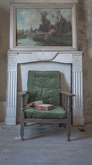 Reading material. (Ewski Images) Tags: sony antique classic vintage urbex fireplace exploration explore book chair painting art abandoned decay
