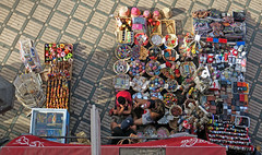 Guys, minding the store - Main Square of the Medina in Marrakesh, Morocco (TravelsWithDan) Tags: guys youngmen fromabove mainsquare oldtown medina marrakesh morocco city urban store sales forsale joking companions friends candid street africa canong3x