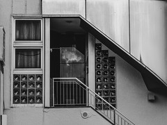 Reflected Sky (kristenscotti) Tags: 150mm 75mm japan photography absoluteblackandwhite architecture art asia black blackandwhite brick building bw city clouds door glass grey highcontrast japanese kyoto lighting lightroom lights microfourthirds mirror modern monochrome olympus outside pattern pen penf photoshop pro reflection shadows sign sky smooth streetlife streetlight streetphotography streetshooter streetshot streetvision summer symmetry texture traditional urban visuals white window