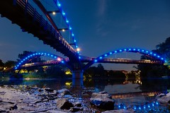 Tridge - Midland, MI (dangaken) Tags: tridge midland midlandmi mi michigan bridge titabawaseeriver chippewariver tittabawasee chippewa river tittabawasseeriver tittabawassee night light dark blue bluelights lights pedestrianbridge footbridge greatlakesbay gogreatlakesbay fuji fujifilm fujixmount fujinon fujix fujixt2 fujifilmxt2