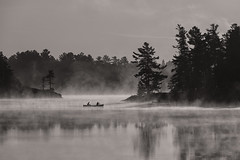 Early Moring Mist -3860 (RG Rutkay) Tags: bw grundytrip canoes coniferous fog hemlocks lake landscape mist monchromatic morning nature nearnorth outdoors reflections silhouette trees wilderness blackwhite