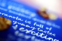 Yummy Printed Word (Explore 09/08/19) (Christian Chene Tahiti) Tags: canon 6d auckland nz nouvellezélande newzealand ganola fruitsec mot bleu blanc impression papier sheet macro amande nut bokeh printedword macromondays