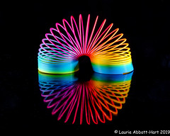 20190808Rainbow Spiral 30057-Edit (Laurie2123) Tags: ad200 fujixt2 fujinon1855mm laurieturnerphotography laurietakespics laurie2123 odc ourdailychallenge offcameraflash reflection slinky