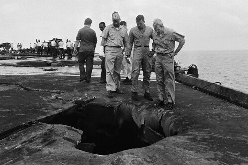 John McCain and Fellow Pilots Examining Hole
