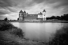 Mir Castle (pietkagab) Tags: mircastle mir castle medieval architecture building palace clouds sky longexposure 10stop nd water belarus belarusian towers tower grass blackandwhite mono europe eastern pietkagab photography piotrgaborek sonya7 travel trip tourism sightseeing adventure