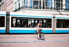 Amsterdam, Netherlands (aqawitt) Tags: amsterdam ams street snap streetphotography shootfilm shooting film filmphotography fm2 dutch nikon netherland nikonfm2 nikkor negative people tram 35mm ektar100 ektar kodak kodakektar100 holland