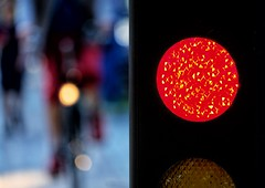 Stop and Go (Geolilli) Tags: stoplight light bicycle traffic bike person people blur bokeh timmendorfer germany red transportation fujifilm xt20