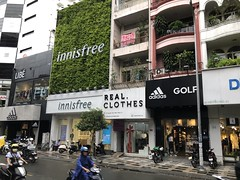 Shop selling real clothes (Simon_sees) Tags: asia vietnam saigon hochiminhcity city streetscape realclothes stores store shopping shops signs