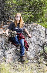 Sitting In The Rock Chair (wyojones) Tags: wyoming sunlightbasin sunlightcreekcanyon chiefjosephhighway ani rock lichens woman redhead glasses ginger beautiful cute seriouslook limberpine glacialerratic boulder girl