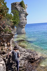 Scrambling around to see Big Flowerpot (daveynin) Tags: fathomfive nationalpark brucepeninsula canada ontario rockpillars seastack lake bay georgian marlena