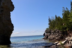 Family of five scrambling the rocky cliffs (daveynin) Tags: ontario canada nationalpark bay lake brucepeninsula rockpillars seastack coast tourists