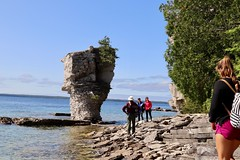 Approaching to see small Flowerpot (daveynin) Tags: fathomfive brucepeninsula nationalpark canada ontario lake bay seastack rocks rockpillars georgian