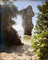 David taking break and watching sea stack, Big Flowerpot (daveynin) Tags: ontario canada nationalpark bay lake brucepeninsula rockpillars seastack coast lunch mememe