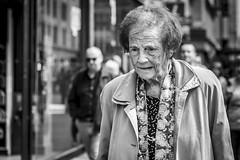 Weight of the World (Leanne Boulton) Tags: urban street candid portrait portraiture streetphotography candidstreetphotography candidportrait streetportrait streetlife old elderly woman female face eyes expression mood emotion feeling sadness sad pain hardship soul worry concern tone texture detail depthoffield bokeh naturallight outdoor light shade city scene human life living humanity society culture lifestyle people canon canon5dmkiii 70mm ef2470mmf28liiusm black white blackwhite bw mono blackandwhite monochrome glasgow scotland uk