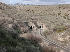 DUEL(ING) TUNNELS (Rob Patzke) Tags: landscape tunnel hill tree river lx100 lumix panasonic railroad desert rock mountain enter exit train gray barron
