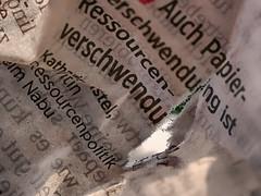 Paper Waste (BeMo52) Tags: backlit fasern gegenlicht hole loch macro makro newspaper printedword riss wörter words zeitung